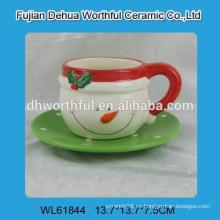 Taza y platillo de cerámica del muñeco de nieve de la nueva Navidad del estilo