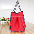 Bolsa de playa plegable perforada roja