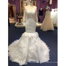 Sirena de manga larga de tul vestidos de novia con volantes parte inferior