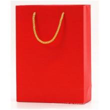 Kleine rote Geschenkkleidungs-Papiertüte, Tasche mit Baumwollgriff