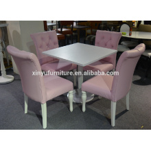 White restaurant table and pink leather chair XYN1806