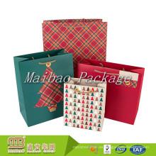 Hermoso diseño personalizado colorido impresión pequeño Navidad papel regalos bolsos para niños