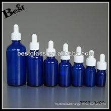 blue essential oil bottle with white plastic cap, white rubber, glass dropper; dropper bottle with white plastic cap