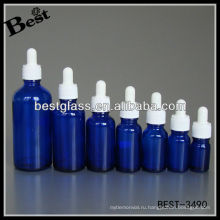 синий эфирное масло бутылка с белым пластиковым колпачком, белая резина, стекло капельницы; капельницы бутылка с белым пластиковым колпачком