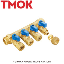 brass color four-way water manifold