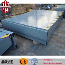 Contenedor hidráulico cargando muelle mecánico nivelador rampas elevación