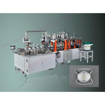 Machine de fabrication de corps de masque de tasse