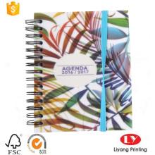 Cuaderno espiral de alambre o encuadernado con banda elástica