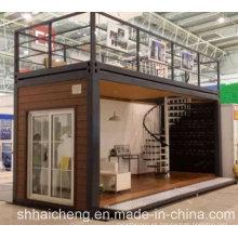 Casas modulares hechas de contenedores de paquete plano