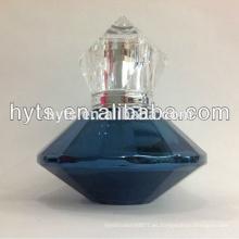 botella de perfume azul encantador