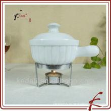 Porcelana mini fondue de chocolate con tenedor