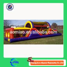 Parcours d'obstacles gonflable bon marché jouant à l'extérieur du parcours d'entraînement