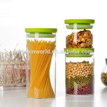 El recipiente de cristal resistente al calor hermético promocional fijó con la tapa plástica verde
