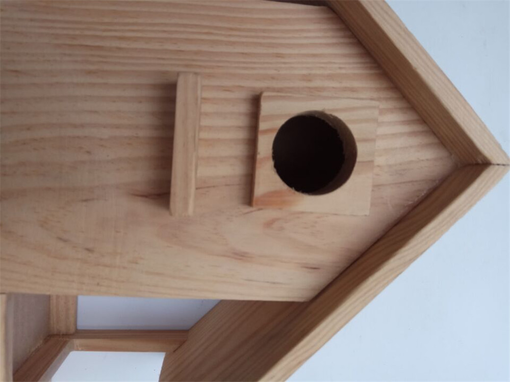 wooden bird house standing