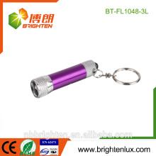 Vente en gros à prix bon marché Mini lampe de poche cadeau de Noël coloré Mode Petite 3Led Torche de clés matal personnalisée