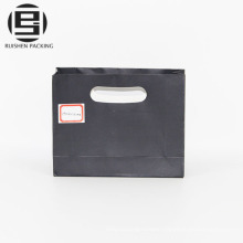 Black shopping paper bag with die cut handles