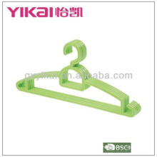 Plastic hanger with trousers bar and racks for straps