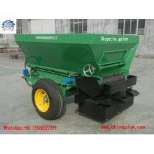 O trator do equipamento da agricultura montou o propagador do adubo de duas rodas para o mercado de Nova Zelândia