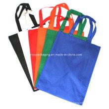 Sacos no tejidos coloridos con manijas