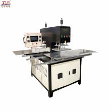 máquina de prensado en caliente para grabar el logotipo en las prendas
