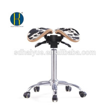 taburete de silla de montar de cuero blanco negro alta qualilty en taburete barbero con base de cromo