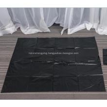 Large Black Garbage Bag on Sheet