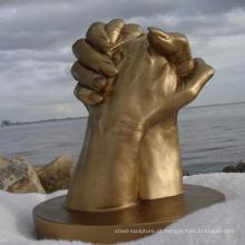 Escultura moderna das mãos do cobre da arte do metal