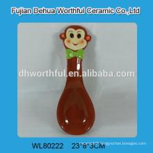 Ceramic spoon rest with monkey figurine