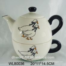 Tetera de cerámica en calcomanía de pato con taza