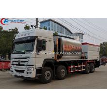 SINOTRUCK 23CBM Bitumen And Gravel Synchronous Seal Truck