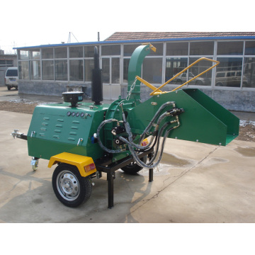 Trailer mounted self powered wood chipper