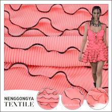 La tendencia de la tela gasa plisada a granel parís rosa de poliéster