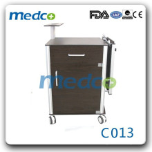 Hospital bedside cabinet with folding overbed table C013