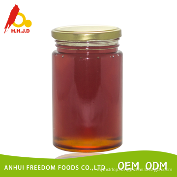 honey with comb packed in 453g glass jar