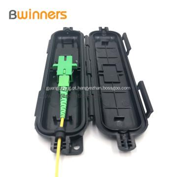 O cabo de gota da fibra óptica que emenda a caixa protetora 1 entrou a saída 1