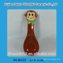 Cuchara de cerámica de mono colorido en el precio del comercio