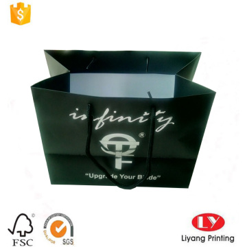 Shopping bag in carta nera con logo argento