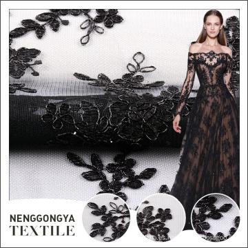 Diseños al por mayor del bordado negro del precio barato con la tela neta