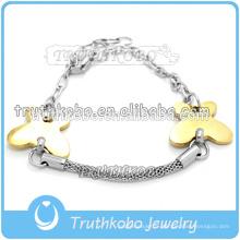 Vente chaude accessoires de mode lady & Bijoux 2016 creux sur bracelet en acier bicolore avec breloque papillon pour femme