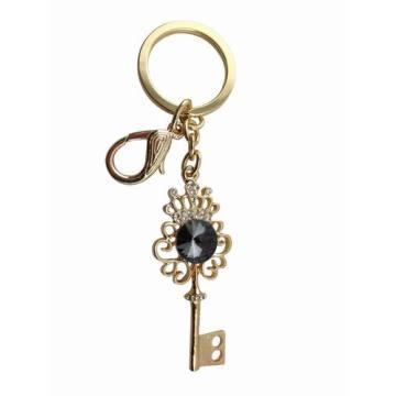 Llavero clave con joyas de diseño con encanto