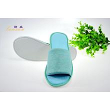 Zapatilla de punta abierta para habitación de huéspedes