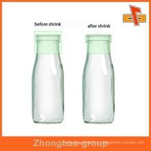 O pvc quente da venda encolhe o selo plástico do tampão de frasco da luva para o leite