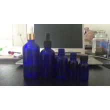 Serie de botella de cuentagotas de vidrio de alta calidad azul cobalto