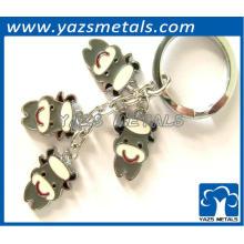 El ganado de lechería encantador formó el keychain del metal para el regalo y la decoración