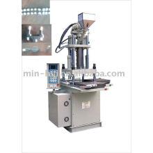 Machine de moulage par injection verticale
