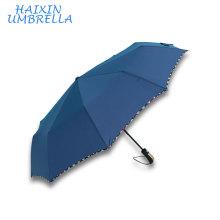 Productos chinos de calidad Sombrillas Promotion Pongee Fabric con Check Border Design Three Folding Umbrella Auto Abrir y cerrar