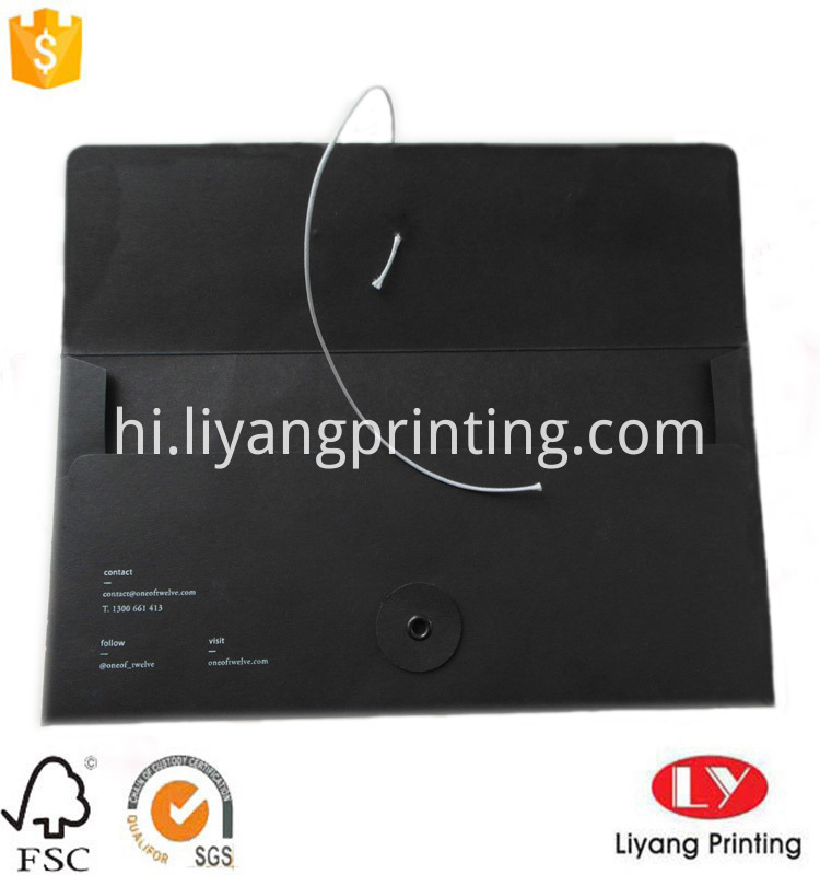 black card envelop with string and button closure