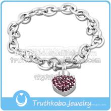 Bracelet de charme de coeur de moucheture pourpre en acier inoxydable de style populaire avec des bijoux en urne en cristal de souvenir