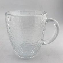 Taza de vidrio transparente con patrón de martillo con asa
