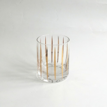 Vaso de vidrio con calcomanía dorada